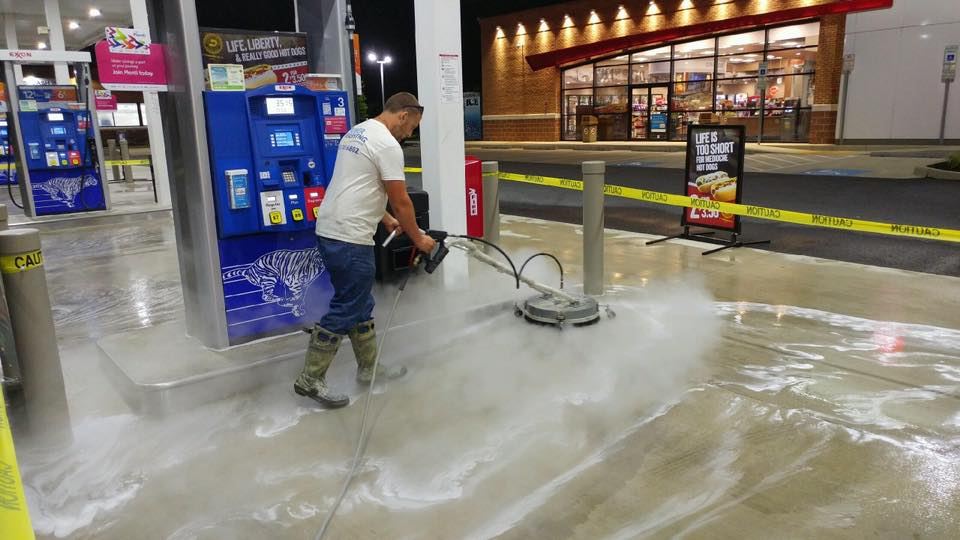 One of our professionals providing commercial cleaning at a gas station